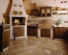 I love this kitchen.  It's like a cross between European and rustic cottage