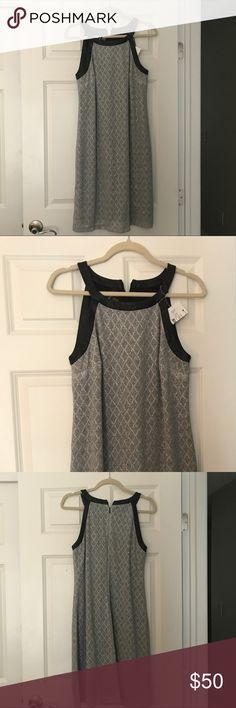 Nine West metallic silver dress Metallic Silver shift halter dress with faux leather trim. Nine West Dresses