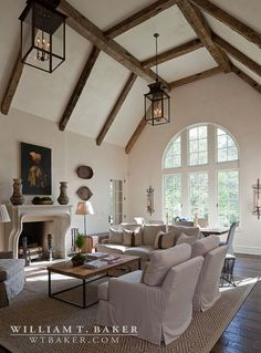 William T Baker Houses | Family room, Fireplace, lanterns, rustic, symmetrical, vaulted ceiling, wooden beams