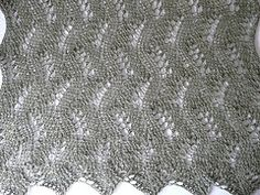 This generously sized shawl showcases the wavy lines of the lace pattern worked in a wonderful baby alpaca yarn. The right side rows of the pattern consist of only two different simple lace stitch sequences and every wrong side row is purled, making this pattern very easy to memorize and knit.