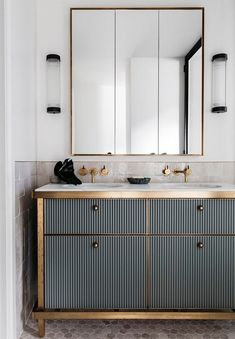 Vanity Unit Brass and vertical stripy panels