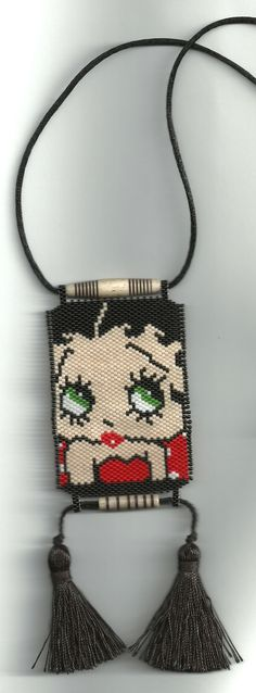 I found this pattern on Pinterest...decided to put my own spin on it...Betty Boop...peyote beaded necklace