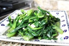 STIR-FRIED SNOW PEA LEAVES WITH GARLIC - The Woks of Life