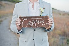 """""""Captain"""" sign  // photo by Closer to Love Photography, Bride's Jewelry: Trigger Jewelry"""