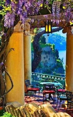 Portal to the Bay of Naples in Sorrento, Italy - the main hotel balcony with collonade and trellis along the cliffside looking onto the bay - breathtaking!