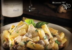 Rigatoni pasta, herb-roasted chicken, mushrooms and caramelized onions, tossed in a Marsala cream sauce.