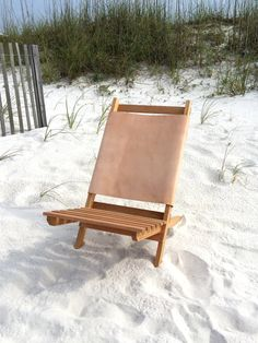 Dreaming of this oak-and-leather camp chair — and this beach —on a frosty February day. #etsyfinds