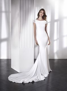 Lara- Fitted crepe dress with open back and diamante cap sleeves