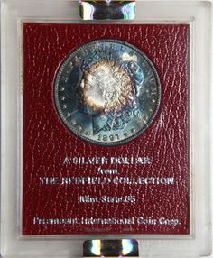 Buy Redfield hoard coins: http://goccf.com/eBay/GradedRedfieldCoins  This is a 1897 Morgan in Redfield holder graded MS 64 by NGC.