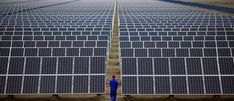 A worker inspects solar panels at a solar Dunhuang, 950km (590 miles) northwest of Lanzhou, Gansu Province September 16, 2013. China is pumping investment into wind power, which is more cost-competitive than solar energy and partly able to compete with coal and gas. China is the world's biggest producer of CO2 emissions, but is also the world's leading generator of renewable electricity. Environmental issues will be under the spotlight during a working group of the Intergovernmental Panel…