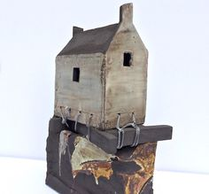 house tied on rock £475