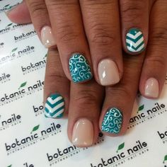teal nude white nails with accent design
