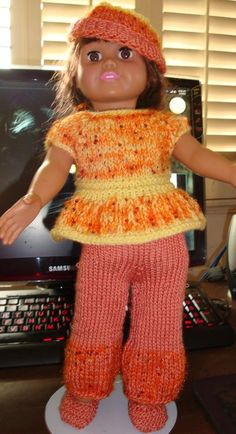 Ladyfingers - AG doll - Peplum Top, Long Pants, Hat - http://static.knittingparadise.com/upload/2013/10/11/1381545853274-american_girl_peplum_top_and_pants.pdf