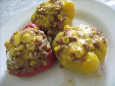 Spicy Tri-Color Vegetarian Stuffed Bell Peppers from Food.com:   								These fantastic peppers were the highlight of another rainy afternoon. I used vegetarian mock ground beef but you can use the real thing if you desire!