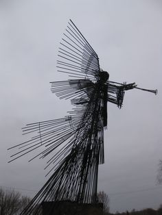 """PART 1. ANGEL with third trumpet of Revelations. Recently erected at the site of the worst disaster in human history, it stands as a memento of the prophesied angel which summons the 'star' of Chernobyl (""""Wormwood"""" in English) from the sky, turning a third of earth's water bitter; the approximate size of the radiation cloud after the event. The radiated pine forest in the exclusion zone is now known as """"Red Forest,"""" prefiguring to the blood red waters of Revelations.......... continued;"""