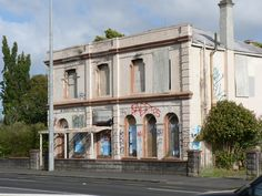 This old hotel once stood pride of place on one of West Auckland's busiest main streets, Great North Road. With many rooms upstairs and a bar, you can bet it had more than a few secrets. Attempts o...