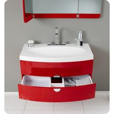 Red vanity, paired with grey walls and white floor rather than tbe other way around. ?.