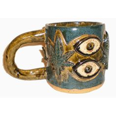 Eye Coffee Cup 18  Ceramic mug with pattern of eyes and Cannabis leaves by Aaron Nosheny / Aberrant Ceramics $34.00