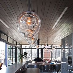 Best Ideas For Modern Interiors Design : – Picture : – Description Riverhouse project by Poonam Khanna of the union works with oversized pendants and a nine globe chandelier by lindsey adelman