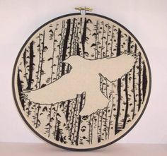 Birch trees and black bird silhouette embroidery