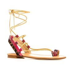 Summer's essential sandal. Grab your passport and transcend fashion frontiers in this exotic Bohemian ankle-wrap toe-ring sandal. Gilded straps add glamour, while amped-up animal-print inserts separate it from the pack. Ready, jet-set, go in denim cutoffs and a slightly-sheer peasant blouse. Wraparound ankle laces Heel measures approximately ¼ inch Available in nappa Leather insole Leather sole Made in Spain