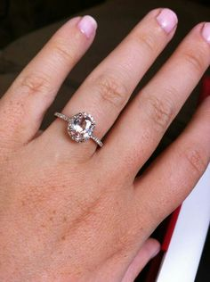 Peach pink champagne sapphire in this ring. I know it's not a diamond, but I LOVE the color of this gem!