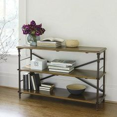 This ingeniously designed Low Bookcase epitomizes the best in French Industrial styling. Iron posts have decorative castings and hidden notches in the back, so you can adjust the shelves and book guards to fit the height of your books.