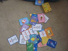 some of my son's flash cards strewn on the playroom floor.   Great picture!