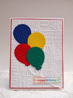 handmade birthday card from Sleepy in Seattle ... luv the birthday words embossing folder texture ... brightly colored balloons in primary colors with string float upwards ... delightful card!!