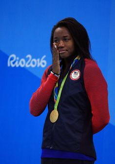 #RIO2016 Simone Manuel of the USA wipes a tear away after winning Gold in the Women's 100m Freestyle Final on Day 6 of the Rio 2016 Olympic Games at the...