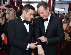 Pin for Later: Rami Malek Was More Adorable Than Ever at the SAG Awards He helped Bryan Cranston get his cufflinks juuuuuust right. Perhaps Cranston was able to share advice about starring in a megapopular TV show while he and Malek made their wardrobe adjustments.