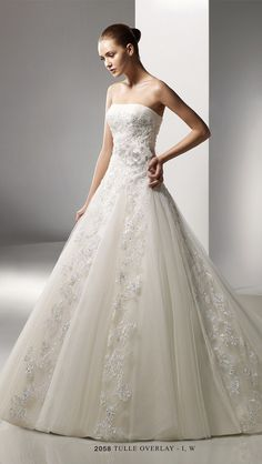 79fc997dcd1 Benjamin Roberts 2058    Tulle and lace fall away gracefully from the waist  of this fairytale dress keeping the full skirt flattering.