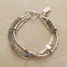 Sterling silver spools and hammered beads dominate two strands