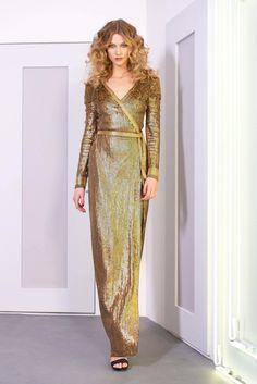 65146b04525f Karlie Kloss models a gold maxi dress from Diane Von Furstenberg s  fall-winter 2016 collection