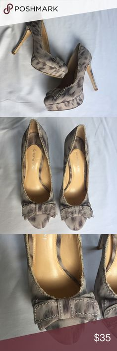 """Gianni Bini Beige and Purple Platform Bow Heels Gorgeous beige heels with a brushed purple pattern all over. Kind of a satin feel to them. Really cute layered bow on the front with contrast stitching. Distressed edges for added texture. Excellent condition, but have been worn as can see by the bottoms. About a 1"""" platform and a 4"""" heel. Gianni Bini Shoes Heels"""