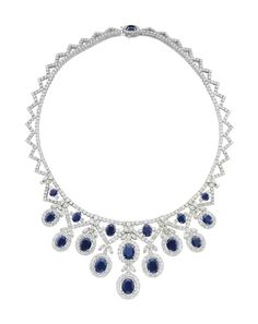 A SAPPHIRE AND DIAMOND NECKLACE The front designed as a tapered fringe of oval-cut sapphires within circular-cut diamond surrounds, accented by marquise-cut diamonds, to the circular-cut diamond neckchain, 17 ins., mounted in 18k white gold