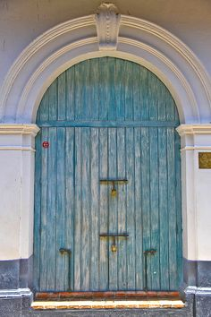 Blue wooden door in Calle Estanco del Tabaco outside La Passion Hotel - Cartagena de Indias, Colombia. By Cedric Converset