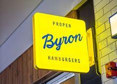 Byron Signage designed by Charlie Smith Design. Shop Signage, Company Signage, Retail Signage, Wayfinding Signage, Signage Design, Environmental Graphics, Environmental Design, Blade Signage, Neon Box