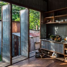 Nishizawa Architects adds movable walls to multi-family home in southern Vietnam Garden; Tropical House Design, Tiny House Design, Tropical Houses, Multi Family Homes, Home And Family, Movable Walls, Unusual Homes, Shed Homes, Architecture Design