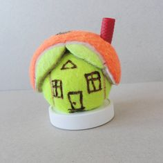 If you see a tennis ball as a synoym for ball, than is this a ball room building