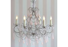 """Pirouette Chandelier - Blush $2,500.00      Normally ships within 4-6 weeks.     Italian Handblown Glass Drops     Measurements: 29"""" x 26"""" with 36"""" chain     Uses six 60 watt bulbs     Imported     Due to special handling needed, please understand there is a 20% restocking fee on oversized Chandelier returns."""