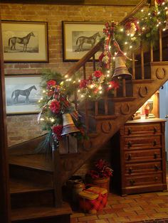 Rustic...decorated staircase for Christmas...with bells.