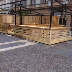 Pallet bar - building and backlighting a bar base similar to this would brighten up the space from the street