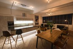 Rigg Ltd of Kings Norton were responsible for the oak dining table with steel legs, Andrew Brettell of Kensington kitchens, Hagley, was responsible for designing the kitchen in the show apartments at Concord House in Marshall Street, Birmingham.
