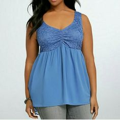 Beautiful Empire Waist Top A beautiful blue empire waist top from Torrid. Lace throughout bust area wrapping around the back. This is a Torrid size 4. This measures approximately 23 inches from armpit to armpit. The front measures 33 inches in length starting from shoulder. 100% Polyester with added lining underneath. Gorgeous top great for the summer! New with tags. Too big for me. Price is firm on this item. torrid Tops Tank Tops