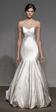 Architectural seamed duchess satin column gown with diagonally draping and tafetta underskirt