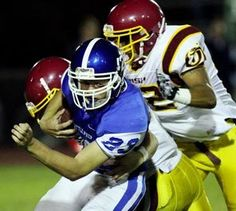 Seattle Prep's Clayton Comiskey (23) can't get far on a second-half kickoff return as he is brought down by a pair of O'Dea tacklers. (Photo by Ken Lambert / The Seattle Times)