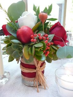 Festive Christmas flowers with berries and succulents. This would look beautiful with some deep red South African proteas. Succulent Centerpieces, Holiday Centerpieces, Succulent Arrangements, Succulent Ideas, Christmas Arrangements, Winter Decorations, Floral Arrangement, Fall Decor, Holiday Decor