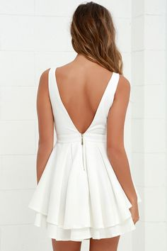 Dangerously sexy will definitely be your M.O. with the tantalizing Flirting with Danger Cutout Ivory Dress! Two layers of triangular cutouts are a stunning addition as they traverse the decolletage of a sleeveless bodice, while a sultry V dips ultra low in back. A woven skater skirt blooms out from box pleats just below a fitted waist, with an extra layer of ruffly fabric at the hem. Exposed gold zipper shines at back. As Seen On Emily of @emilyrosehannon!