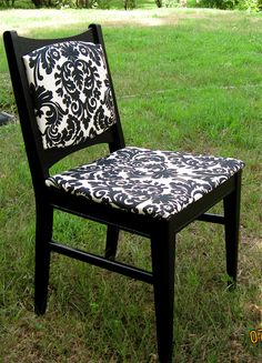 This is an indoor/outdoor occasional chair painted semi-gloss black, and upholstered in bold black & white indoor/outdoor fabric over vinyl for easy cleaning.  SOLD